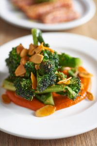 Seared Broccoli with romesco sauce & almonds